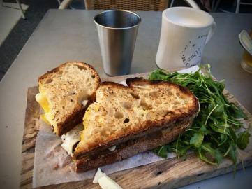 the most amazing egg-bacon-avocado-cheese sandwich + arugula
